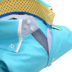 Men's light turquoise shirt double collar and yellow trim upclose