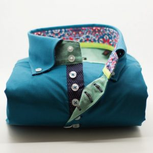 Men's teal single collar shirt with navy trim front